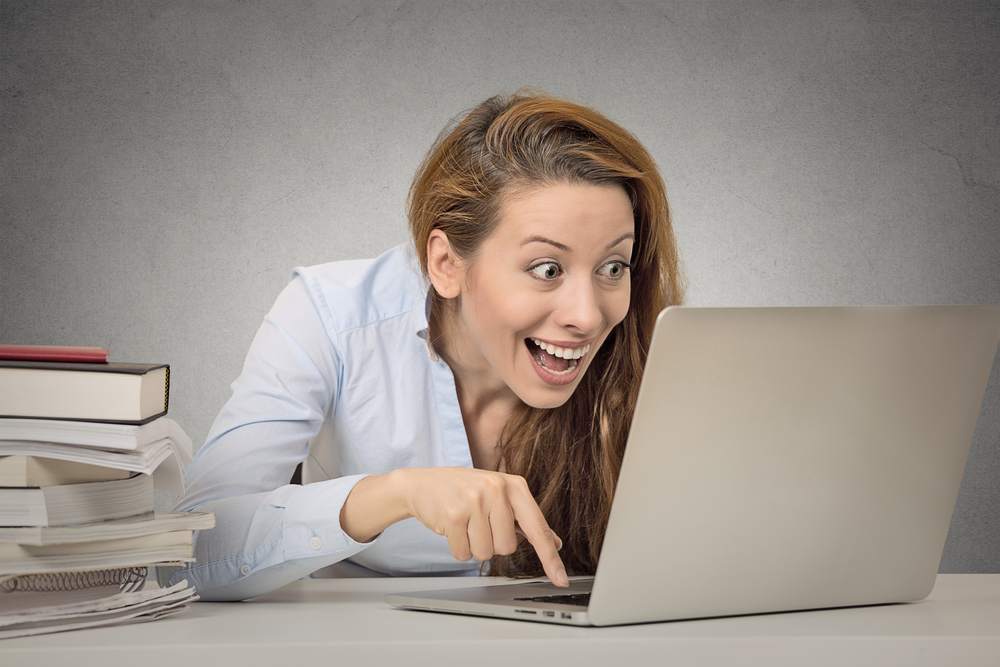 women about to press button on computer excited about finding a summer camp in colorado